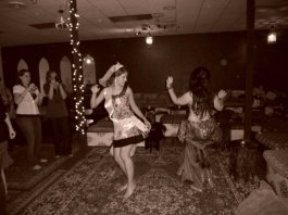 Janim dancing with the Bride-to-Be: A fun time at a bridal shower!